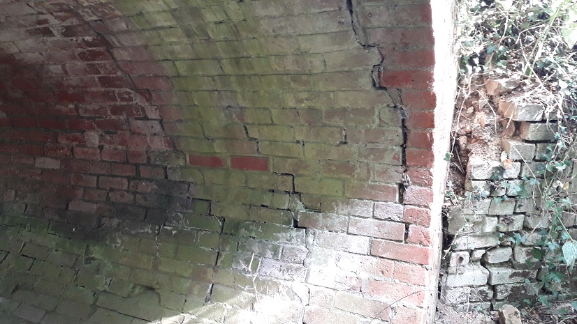 visible cracks in brick arch